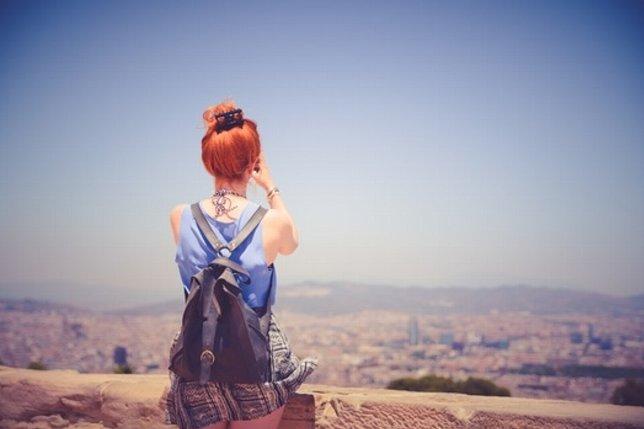 city-woman-view-blue-sky-medium